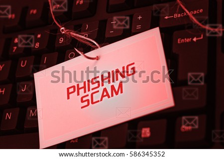 Cyber and Technology concept, digital screen over the keyboard showing PHISHING SCAM.