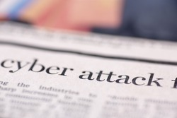 Cyber attack written newspaper. Cyber attack written newspaper, shallow dof, real newspaper.