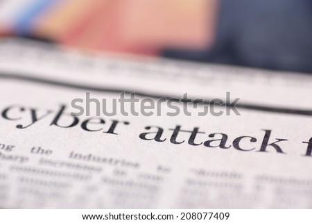 Cyber attack written newspaper. Cyber attack written newspaper, shallow dof, real newspaper.