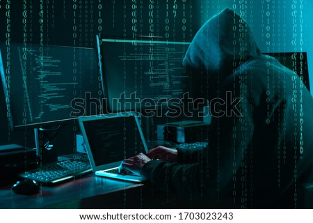 Cyber criminal hacking system at table, digital binary code on foreground Stock photo ©