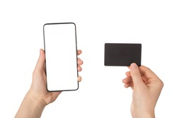 Cyber monday concept. Pov close up view photo of female hands holding smart telephone with blank empty display and black card with bonus certificate isolated white background