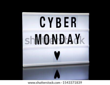 Cyber monday sale signage. Lightbox with text on black background.