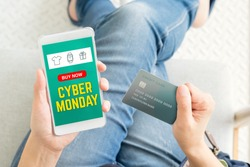 cyber Monday sale using credit card to buy with promo code,Top view close up woman hand shopping online with mobile app,digital marketing concept