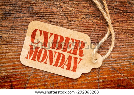 Cyber Monday sign - a paper price tag against rustic red painted barn wood #292063208