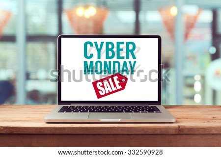 Cyber Monday sign on laptop computer. Holiday online shopping concept. View from above #332590928