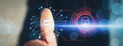 Cyber security and futuristic technology concept businessman using finger to touch fingerprint interface,to scan password,with technology icons and padlock,with artificial intelligence system or ai