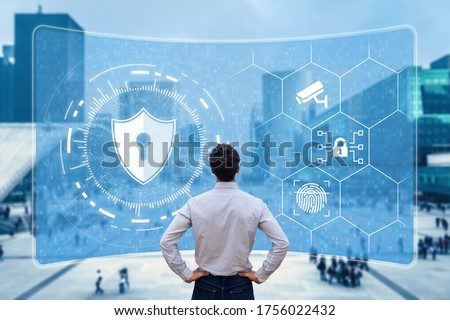 Cyber security and network protection. Cybersecurity expert working with secure access on internet. Concept with icons on screen and office buildings in background. Foto stock ©