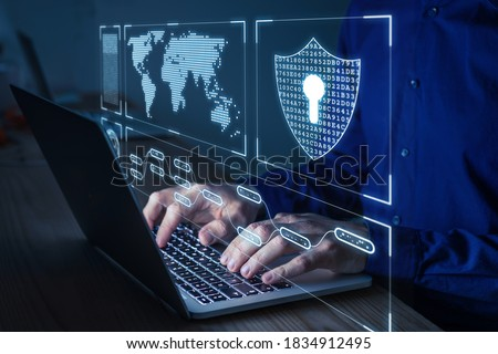 Cyber security and network protection with cybersecurity expert working on secure access internet to protect server against cybercrime. Person typing on computer keyboard late at night