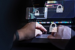 Cyber security, Business, technology, internet and networking, software development, digital data protection concept. Hacker hacking data on laptop computer with pop up antivirus system