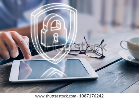 Cyber security on internet concept with 3d padlock and shield, protect personal data and privacy from cyberattack and hacker, secure access on digital tablet computer - Shutterstock ID 1087176242