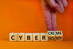 Cyber-security vs cybercrime symbol. Businessman turns wooden cubes, changes words Cybercrime to cyber-security. Beautiful orange background. Cyber-security vs cybercrime concept. Copy space.