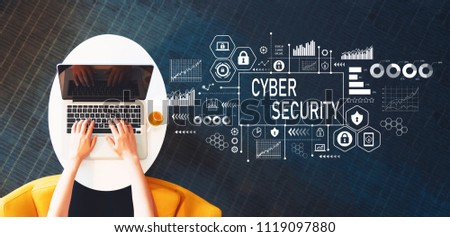 Cyber Security with person using a laptop on a white table #1119097880