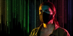 cybercrime, hacking and technology concept - young female hacker in black mask over binary code numbers on black background