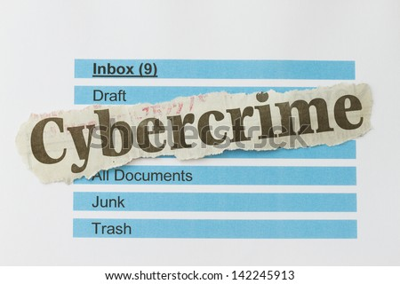 Cybercrime newspaper cutout over an email inbox abstract.