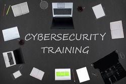 Cybersecurity training concept. Top layout of drawings of laptops, notepads, coffee, different business stuff on black background.