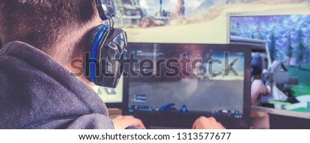 Cybersport,esport.  Professional Gamer Plays in Strategy Video Game on  Computer. Cyber ??Games Tournament, Plays at Home, or Internet Cafe. #1313577677