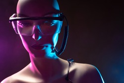 Cyborg. Droid. Robot design. Robot is made very similar to a woman. Close-up of a cyborg woman's face. Concept - robot design. Droid in large glasses close-up. Design cyborg woman in glasses.