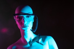 Cyborg woman on a dark background. Robot. Humanoid cyborg woman. Wire comes from robot glasses. Cyborg with artificial intelligence. Concept - development of artificial intelligence. Robot person