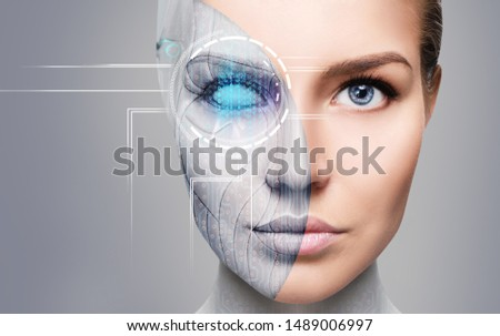 Cyborg woman with machine part of her face. Over gray background. Сток-фото ©