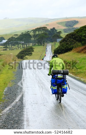 Cycle tourists on a dirt road in New Zealand