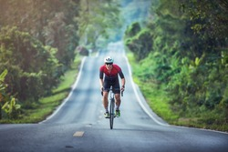 Cycling competition, cyclist athletes riding a race at high speed on mountain road, Sportsmen bikes in the morning,