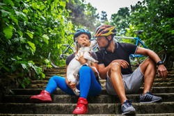Cycling family with their dog.
