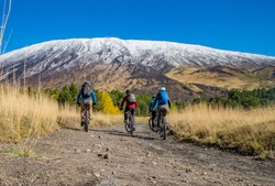 Cycling, mountain biker on cycle trail in autumn forest. Mountain biking in autumn landscape forest. Volcano Etna. Sicily