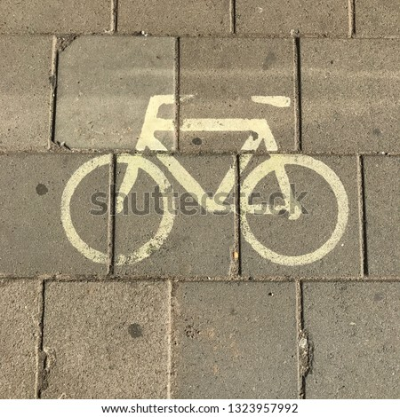 Cycling path, signaling of a bike symbol on the pavement #1323957992