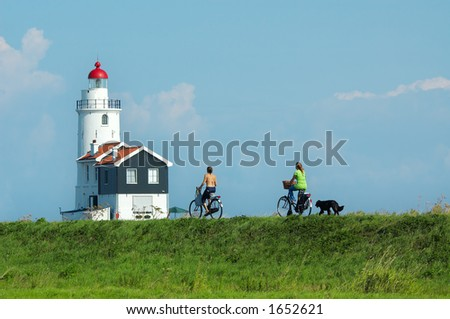 cycling towards the lighthouse on a summerday 