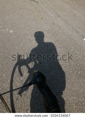 cycling under the hot sun #1026156067