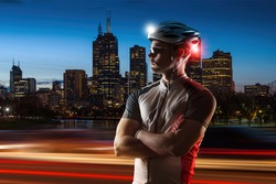 Cyclist at night with bike lights on his helmet