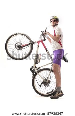 Cyclist carrying a mountain bike