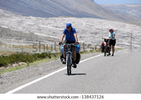 Cyclist  climbing a hill in North Argentiene