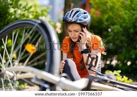Cyclist Fell Down From Bike. Bicycle Injury Stock photo ©