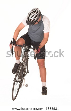 Cyclist getting onto bicycle
