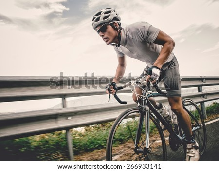 Cyclist in maximum effort in a road outdoors