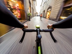 cyclist in traffic on the city roadway motion blur. POV Original point of view