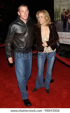 Cyclist LANCE ARMSTRONG & singer SHERYL CROW at the world premiere, in Hollywood, of Along Came Polly. January 12, 2004