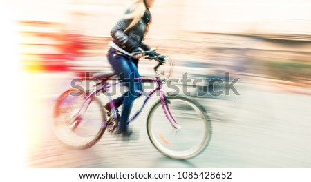 Cyclist on the city roadway in motion blur. Vintage filter with intentional color shift #1085428652