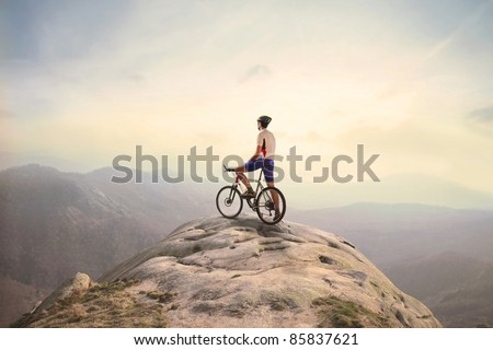 Cyclist on the top of a hill #85837621