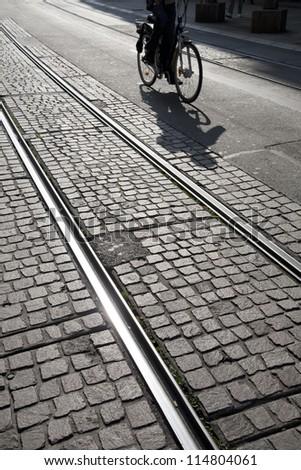 Cyclist on Tram Track in Geneva, Switzerland