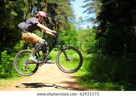 Cyclist rides through the forest