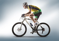 Cyclist riding a bicycle isolated against white background