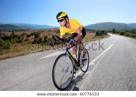 Cyclist riding a bike on an open road