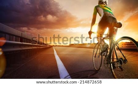 cyclist riding a bike on an...