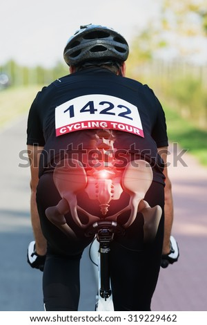 Cyclist riding a bike with digital composed hip bones and spine