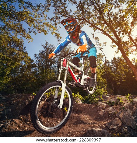 Cyclist riding a mountain bike downhill style Extreme sports on a bicycle outdoors