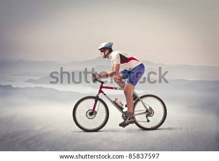Cyclist riding a mountain bike in a desert
