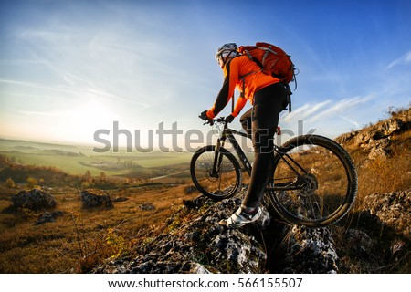 cyclist with a backpack #566155507