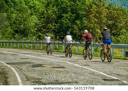 Cyclists on mountain road - Shutterstock ID 563119708